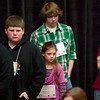 Record-Eagle/Jan-Michael Stump<br /> Abigail Fox, middle, waits for her turn in the Grand Traverse Regional Spelling Bee. Fourth-grader Fox, 9, was the youngest competitior in this year's bee.