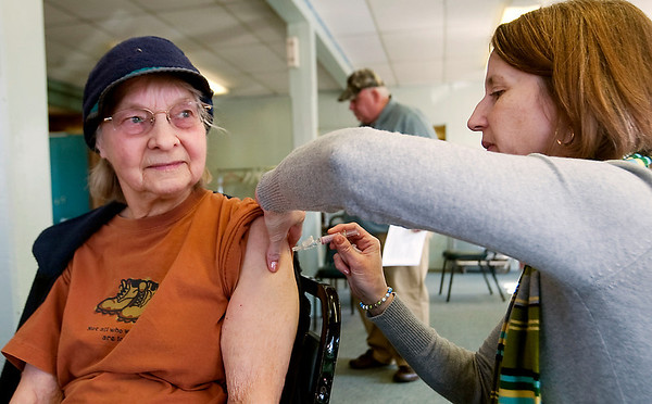 Record-Eagle/Douglas Tesner<br /> Cornelia Hart, left, 85, takes advantage of an H1N1 flu vaccine clinic at the Traverse City Senior Center. Kim White administers the shot.