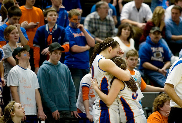 Record-Eagle/Jan-Michael Stump<br /> Central Lake's Jasmine Hines (40) and Sheila Crouse (33) share a hug after both fouled out in Thursday's loss to Adrian Lenawee Christian in the state Class D semifinals at the Breslin Student Events Center in East Lansing.