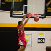Record-Eagle/Jan-Michael Stump<br /> Suttons Bay's Dwuan Anderson dunks in a game against Glen Lake earlier this season. Anderson leads the Norsemen into today's quarterfinal in Sault Ste. Marie.