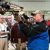 Record-Eagle/Douglas Tesner<br /> Fred Peplinski, of Cedar, takes aim with a crossbow at Gauthier's Archery display at the annual Traverse City Hunting and Fishing Expo at the Grand Traverse County Civic Center.