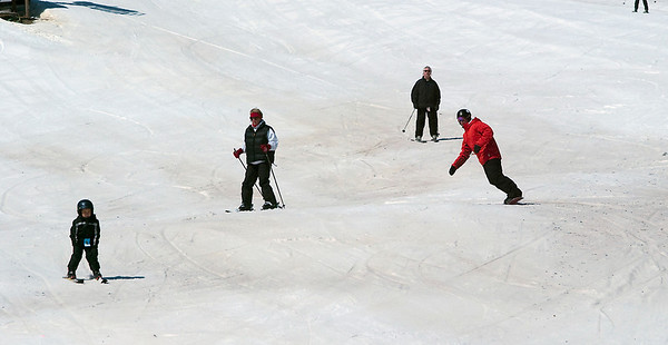 Record-Eagle/Douglas Tesner<br /> Skiers and snowboarders enjoy the final days of skiing this season at Crystal Mountain Resort & Spa.