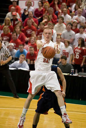 Record-Eagle/Jan-Michael Stump<br /> Suttons Bay's David Wheelock (5) grabs a rebound against Bridgman in Thursday's state semifinal game at the Breslin Center in East Lansing.