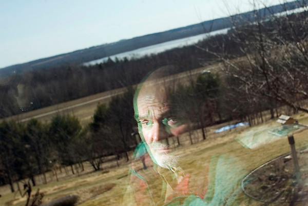 Record-Eagle/Jan-Michael Stump<br /> Jim Fuscaldo, visible ina window reflection, feels a bill intended to protect Michigan groundwater could essentially turn over all natural resources on private property to the state, which he says is an unconstitutional activity.