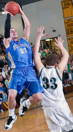 Record-Eagle/Douglas Tesner<br /> Buckley's Josh Ledford (21) shoots over Muskegon Western Michigan Christian's Elliott Vanderlaan.