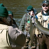 Record-Eagle/Douglas Tesner<br /> Dave McLaughlin shows off his two steelheads he caught as he and some of his friends did some spring fishing on the Betsie River below the Homestead Dam Friday.
