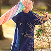 "Record-Eagle/Jan-Michael Stump<br /> Chris Morey looks for a spot to hang her rainbow-colored wind sock outside her Webster Street home on a sunny Monday afternoon. ""It's my obligation to amuse the neighborhood,"" she said of the colorful decorations on her purple home."
