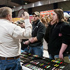 Record-Eagle/Douglas Tesner<br /> Brittney Horwood, right, and her husband, Matt, center, of Grayling, receive some advice on the use of Finn Spoons fishing lures from Capt. Jim Maki, left, at the annual Traverse City Hunting and Fishing Expo at the Grand Traverse County Civic Center.