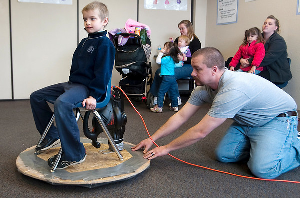 Record-Eagle/Douglas Tesner<br /> Jayden Humphrey receives a ride on a hovercraft created by Roman McDaniel as Roman's father, Ray McDaniel, guides the craft. The Grand Traverse Academy upper elementary students, grade 4-6, hosted a science fair at the school showing more than 170 projects.