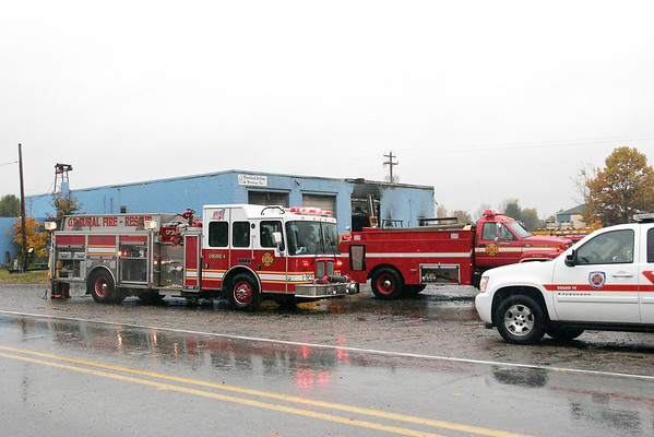 Record-Eagle/Douglas Tesner<br /> Grand Traverse County Rural Fire Department firefighters from Engine 4 responded to the Oct. 23, 2009, fire at Wheelock & Sons Welding on North Long Lake Road.