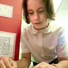 Record-Eagle/Douglas Tesner<br /> Audra Howard, 9, works with a la light bulb at her science project about electrical conductivity.