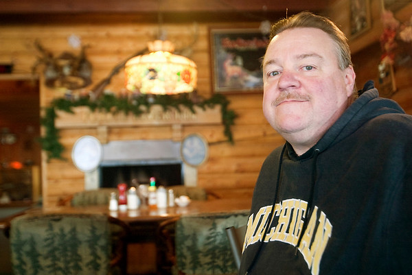 Record-Eagle/Douglas Tesner<br /> Paul Money sits inside Money's Platte River Inn, a family-owned restaurant in Honor since 1951, which up for sale. The business traditionally closes every March, and will not reopen this year.