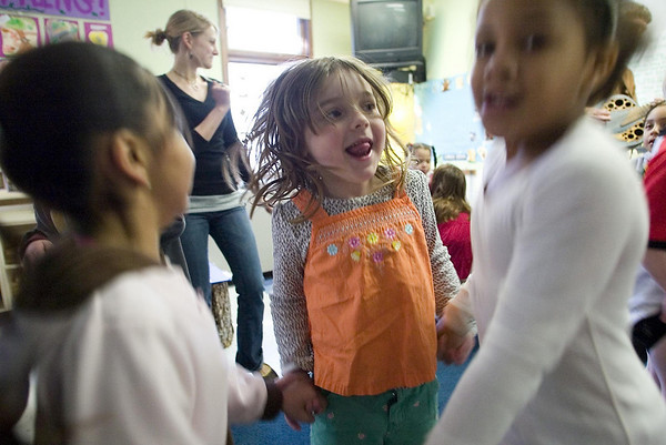 Record-Eagle/Jan-Michael Stump<br /> Leelanau Children's Center students, from left, Daniela Gayton, Paige Cook and Skylar Butz, dance to the music of Doug Hansen during a song-and-dance class session Wednesday.