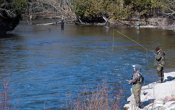 Record-Eagle/Douglas Tesner<br /> People fish for steelhead on the Betsie River just below the Homestead Dam.