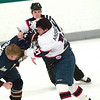 Record-Eagle/Douglas Tesner<br /> Traverse City's Kelin Ainsworth (27) and Janesville's Mike Thompson (4) square off in a first-period fight.