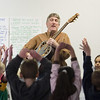 "Record-Eagle/Jan-Michael Stump<br /> Doug Hansen, the Leelanau Children's Center's ""Music Man,"" leads a group of students through song and dance during a Wednesday class session."