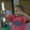 """Record-Eagle/Jan-Michael Stump<br /> Braden Martin practices conducting to Beethoven's """"Symphony No. 5"""" during a visit by Doug Hansen, the """"music man"""" of the Leelanau Children's Center, on Wednesday."""