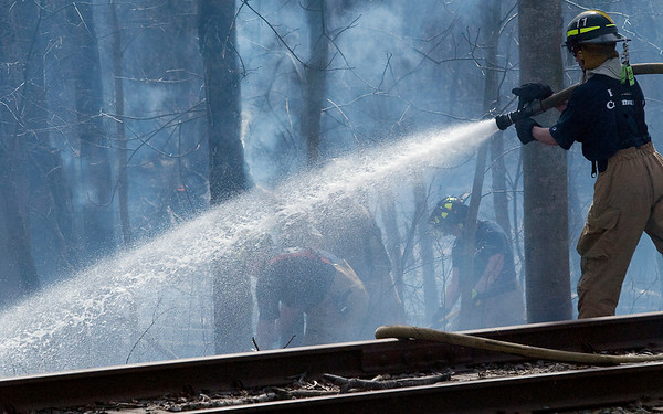 Record-Eagle/Douglas Tesner<br /> Firefighters from several local fire departments fight a wildfire near 790 River Road. The fire destroyed a barn and threatened several other structures.