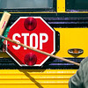 "Record-Eagle/Jan-Michael Stump<br /> TCAPS bus driver Jeff Pataky scrubs the side of a school bus Tuesday afternoon outside Sabin Elementary School. Drivers used rented equipment from Sparkle Wash to clean the approximately 140 buses in the fleet after a problem occurred with the BATA wash they normally use. ""This is plan B,"" said Pataky."