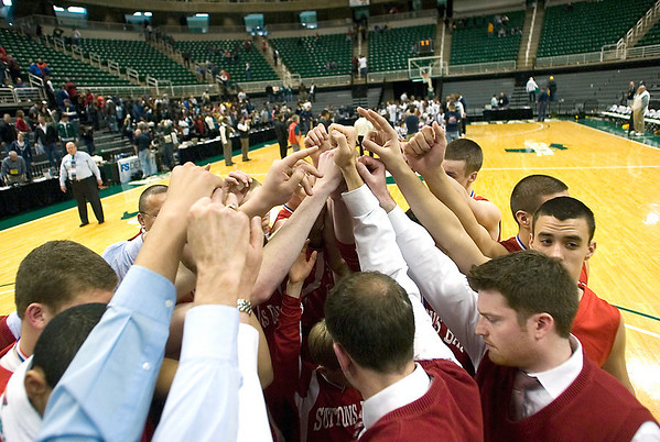 Record-Eagle/Jan-Michael Stump<br /> Suttons Bay players huddle following their loss to Melvindale ABT in the Class C state championship game Saturday at Michigan State University's Breslin Center in East Lansing.