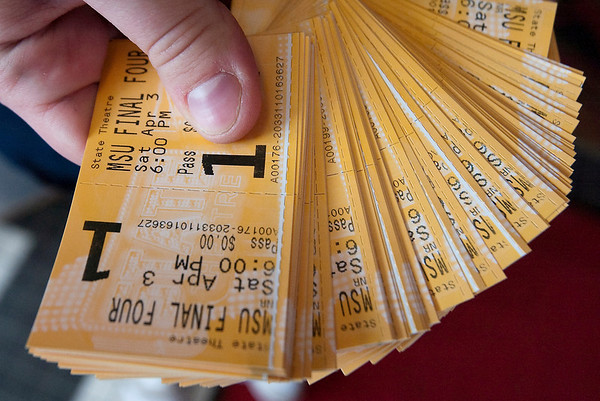 Record-Eagle/Douglas Tesner<br /> <br /> Susan Borke holds free tickets t0 Saturdays showing of the final four game between Michigan State Butler at State Theatre.