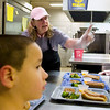 Record-Eagle/Jan-Michael Stump<br /> Food Services Director Janis Groomes serves lunch to first-grader Diego Campos in the Northport Public Schools cafeteria.