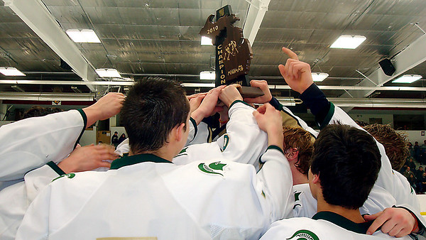 Record-Eagle/James Cook<br /> Traverse City West hockey players celebrate after winning a regional title in Big Rapids on Saturday.