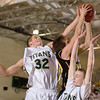 Record-Eagle/Jan-Michael Stump<br /> Traverse City Central's Ben Fischer (24) drives through Traverse City West's Jake Fisher (32) and Graeme Placek (30) in Wednesday's district playoff game.