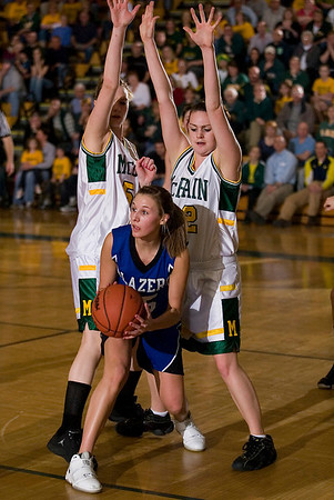 Record-Eagle/Jan-Michael Stump<br /> McBain's Danielle Hoekwater (54) and Brittany Watson (32) guard Kalkaska's Kelli Guy (4) in Thursday's regional playoff game.