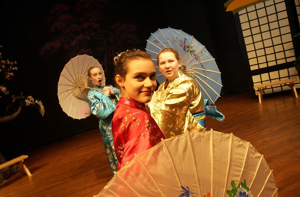 "Record-Eagle/Garret Leiva<br /> Yum-Yum, Sage DeAgro-Ruopp, center, Peep-Bo, Alyssa Pataky, right, and Pitti-Sing, Zoey Marsh, left, sing ""Three Little Maids"" in the Woodland School's production of ""The Mikado."" The school's spring musical will be held 7 p.m. Thursday; 9:30 a.m., 12:30 p.m. and 7 p.m. Friday in the school auditorium, 7224 Supply Road, Traverse City. Admission is $4; tickets sold at the door. For more information, call Woodland School at 947-7474."