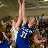 Record-Eagle/Jan-Michael Stump<br /> McBain's Danielle Hoekwater (54) has her shot blocked by Kalkaska's Mariska Bruggenthigs (31) in Thursday's regional playoff game.