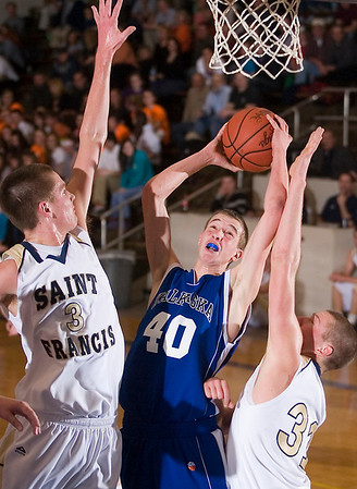 Record-Eagle/Jan-Michael Stump<br /> Traverse City St. Francis' Sean Sheldon (3) and Ian Sheldon (31) try to block the shot of Kalkaska's Kevin Jenkins (40) in Monday's district game.