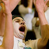 Record-Eagle/Jan-Michael Stump<br /> Traverse City West junior Max Hughes (cq), 17, cheers during the Titans' win over Traverse City Central in Wednesday's district playoff game.