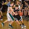 Record-Eagle/Jan-Michael Stump<br /> Elk Rapids' Luke Morrison (3) gets fouled by Forest Area's Victor Woodhams (11) near the end of Monday's district game.