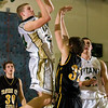 Record-Eagle/Jan-Michael Stump<br /> Traverse City West's Evan Schultz (24) shoots over Traverse City Central's Mack Sovereign (32) in Wednesday's district playoff game.