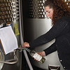 "Record-Eagle/Bill O'Brien<br /> Left Foot Charley Winery tasting room manager Stacey Duncan draws some 2008 Pino Grigio through a new tap delivery system designed to reduce bottling waste at the winery, located at The Village at Grand Traverse Commons in Traverse City. Winery owner and winemaker Bryan Ulbrich said the business will distribute some of its wine through refillable 1-liter ""growlers"" inspired by European wineries for cost savings that are passed on to customers. ""It's crazy to bottle wine just so that i can be carried 50 feet to poured out at the bar,"" he said."