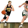 Record-Eagle file photo/Jan-Michael Stump<br /> TC Centrals Dori Lansbach (22) and TC Wests Alaina Hall (20) could meet again in a Class A district title game.