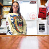 """Record-Eagle/Vanessa McCray<br /> Tina Osterhouse stands behind the counter of the quirky, Starvation Lake-adjacent The Lil' Country Store, where a few customers have asked about Bryan Gruley's mystery titled """"Starvation Lake."""" The store posted a sign advertising the book's themes: """"A frozen lake, A dead hockey coach, a little town with big secrets."""" Osterhouse said she assures customers that the book is all fiction."""