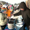 Record-Eagle/Lindsay VanHulle<br /> Visitors at the fourth annual Northport Winter Carnival wait to receive samples during a chili cook-off contest.