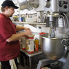 Record-Eagle/Jodee Taylor<br /> Jeremiah Symons mixes cake batter in the kitchen at the Grand Traverse Pavilions. The staff feeds 1,200 people each day.