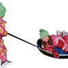 Record-Eagle/Lindsay VanHulle<br /> Gemma Lerchen, 3, pulls friend Grace Corbin, 6, both of Empire, as they sled at Braman Hill Recreation Area during the fourth annual Northport Winter Carnival.