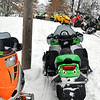 Record-Eagle/Vanessa McCray<br /> A line of snowmobiles park up the hill from a snow-covered Starvation Lake, located in Kalkaska County's Blue Lake Township. Inside the nearby bar The Hideaway, a few locals discussed a new mystery set in a fictional northern Michigan town called Starvation Lake. Bryan Gruley's book is inspired by the woodsy area's snowmobile and hockey culture.