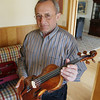 Record-Eagle/Keith King<br /> Jack Segal, of Traverse City, holds the violin Tuesday that was stolen from his home and recovered. The violin was made in Germany between 1700 and 1720.