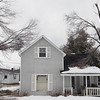 Record-Eagle/Keith King<br /> Tree branches lie on and near a house last week in Lake Ann.