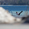 Record-Eagle/Jan-Michael Stump<br /> Tracy Sulser, of Traverse City, plays on a swing in Suttons Bay Marina Park while spending the day exploring with her husband, Steve Sulser.