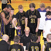 Record-Eagle/James Cook<br /> Leland coach Jon Kissel, center, talks to his team during a 46-42 win over Frankfort on Monday in the Class D regional semifinal at Bellaire. The Comets play the host Eagles on Wednesday for the regional title.