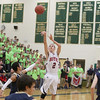 Record-Eagle/Keith King<br /> Boyne City's Corey Redman shoots over Traverse City St. Francis guard Devin Sheehy.