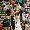 Record-Eagle/Keith King<br /> Traverse City St. Francis sophomore Byron Bullough shoots a three-pointer over Boyne City's Jay Redman on Monday at Traverse City West.