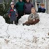 Record-Eagle/Jan-Michael Stump<br /> Mike and Julie Gaines stand outside their Madison Street home with their children Cooper, 2, Molly, 8, and Thomas, 9, and the snow fort they built after this weekend's snowstorm.