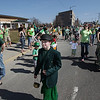 Record-Eagle/Keith King<br /> Eamonn McGonigle, 11, of Interlochen, and others wearing their own versions o' the green travel along Front Street as the annual marching festivities wrap up.